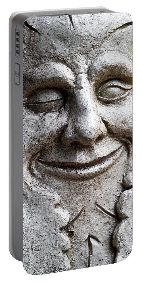 Sculpture Portable Battery Charger featuring the photograph A Wink And A Smile by Christopher Holmes