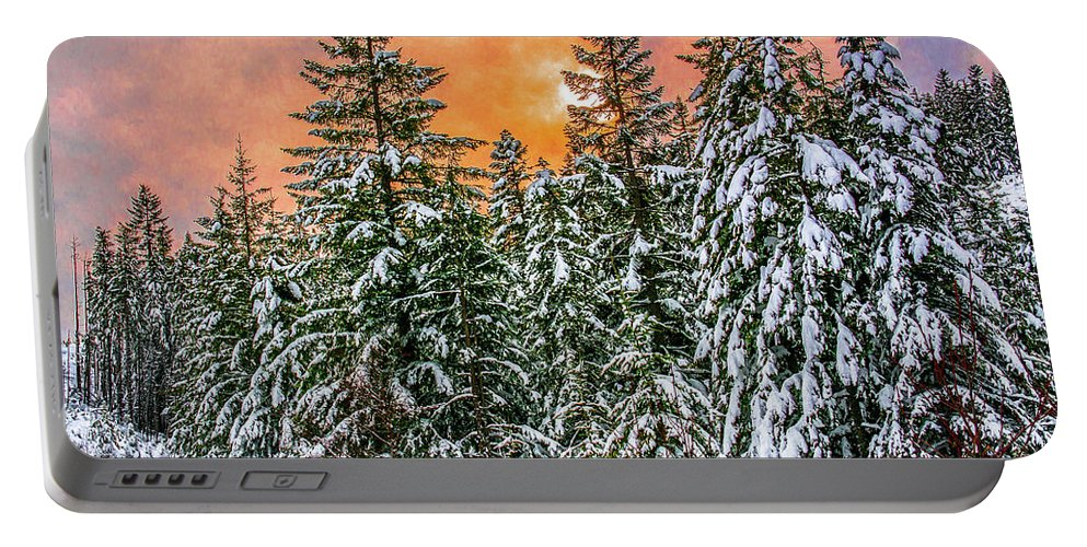Sunset Portable Battery Charger featuring the photograph A winters sky set ablaze by Jason Brooks