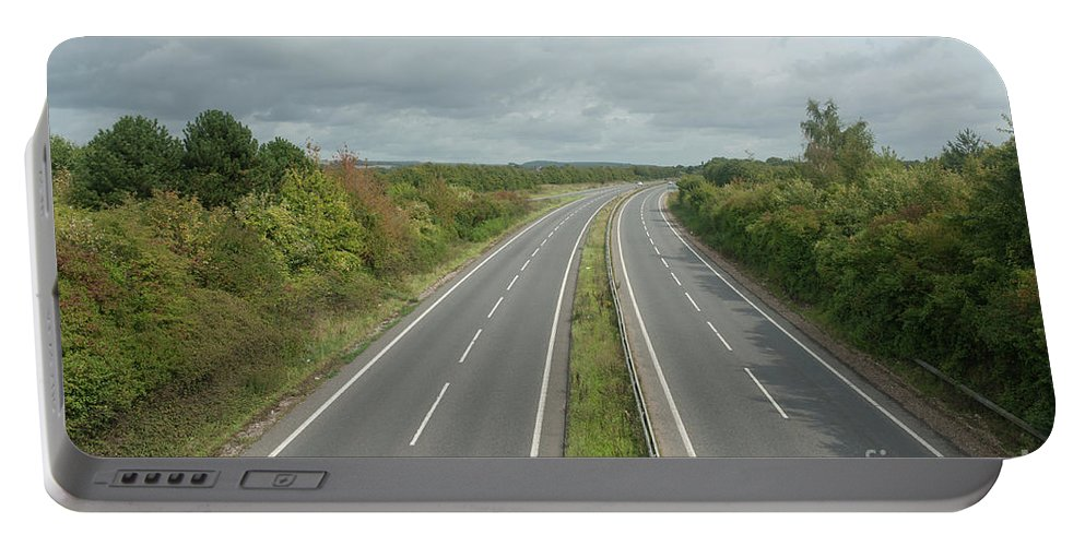 United Kingdom Portable Battery Charger featuring the digital art A27 Dual Carriageway Totally Clear Of Traffic. by Richard Wareham