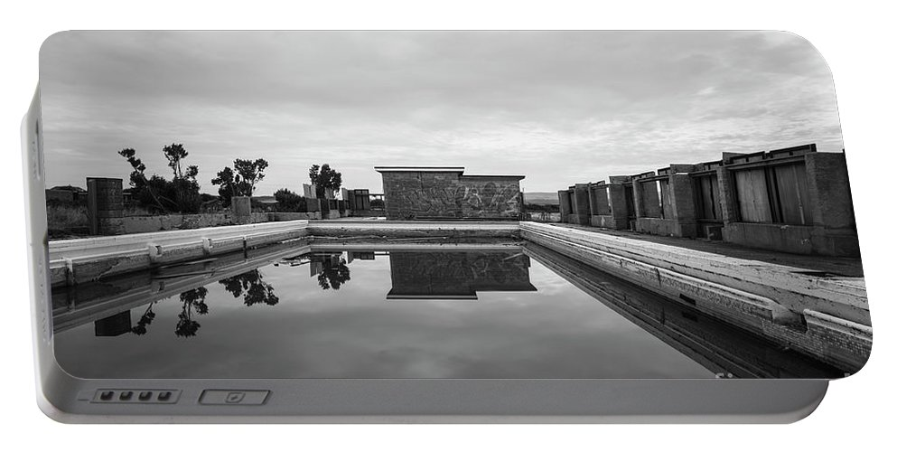 Outdoors Portable Battery Charger featuring the photograph Abandoned Swimming Pool by Clayton Bastiani