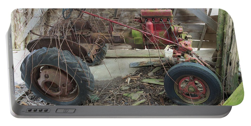 Abandoned Portable Battery Charger featuring the photograph Abandoned Tractor by Timothy Ruf
