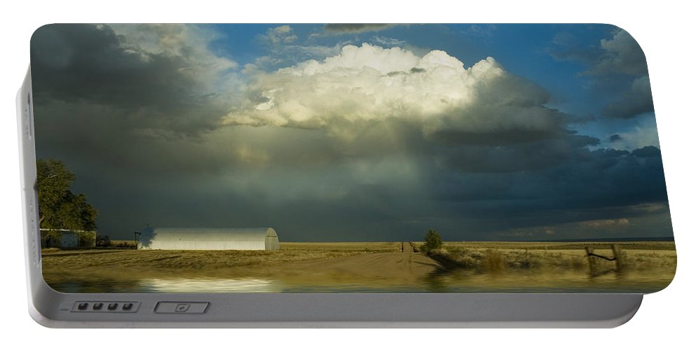 Storm Portable Battery Charger featuring the photograph After The Storm by Jerry McElroy