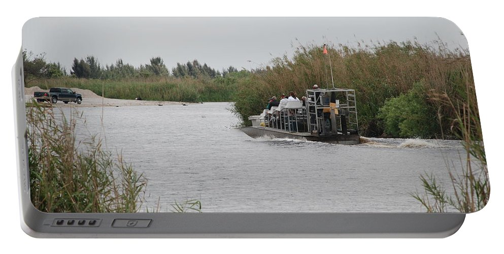 Everglades Portable Battery Charger featuring the photograph Airboat Rides 25 Cents by Rob Hans