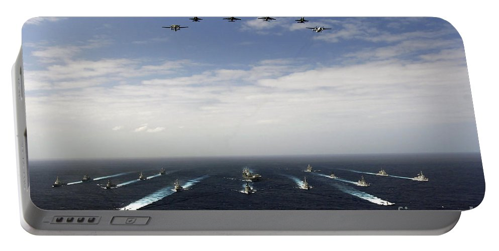 Horizontal Portable Battery Charger featuring the photograph Aircraft Fly Over A Group Of U.s by Stocktrek Images