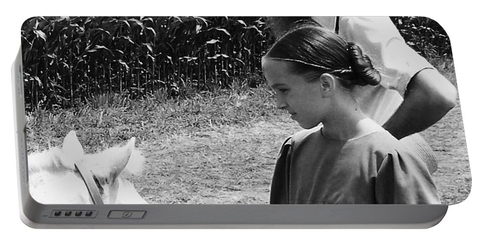 Amish Portable Battery Charger featuring the photograph Amish Girl And Pony by Eric Schiabor