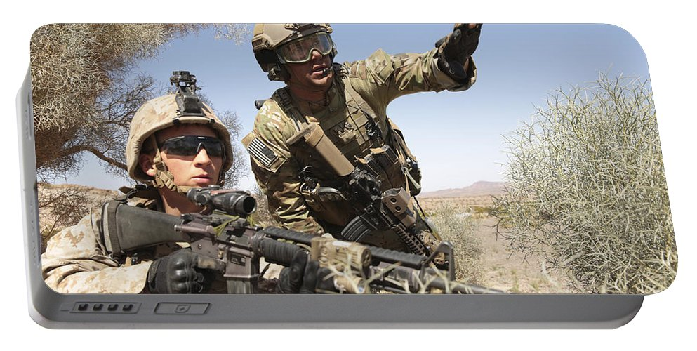 Combat Portable Battery Charger featuring the photograph An Army Soldier Informs A Marine by Stocktrek Images