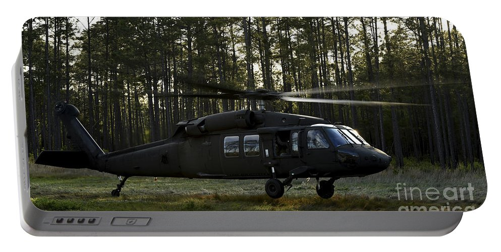 Exercise Emerald Warrior Portable Battery Charger featuring the photograph An Hh-60 Pave Hawk Evacuates Injured by Stocktrek Images