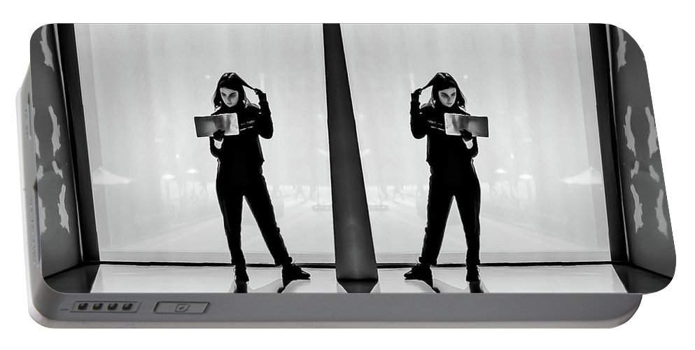 Book Portable Battery Charger featuring the photograph An Interesting Book by Christoph Mueller