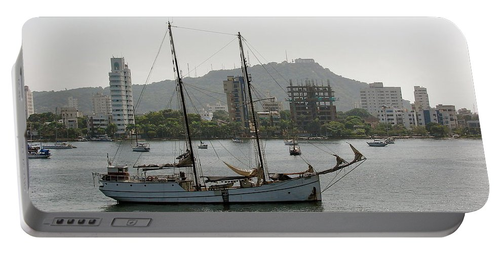 Ship Portable Battery Charger featuring the photograph Anchored Sailboat by Brett Winn