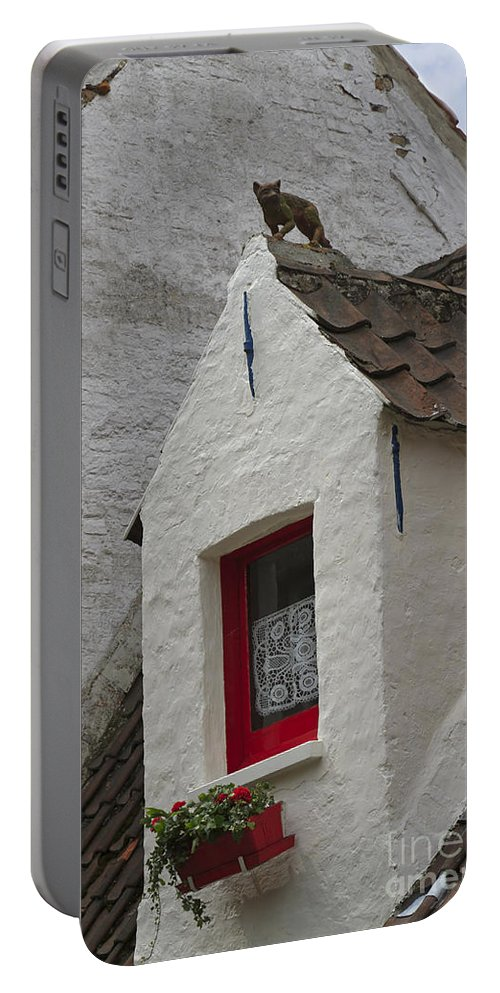 Animal Portable Battery Charger featuring the photograph Animal Statue On The Dormer Roof Of A House In Bruges Belgium by Louise Heusinkveld