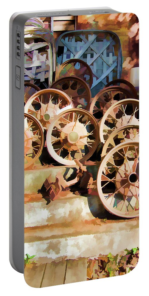 Wheel Portable Battery Charger featuring the photograph Antique Wagon Wheels And Baskets by Jennifer Stackpole