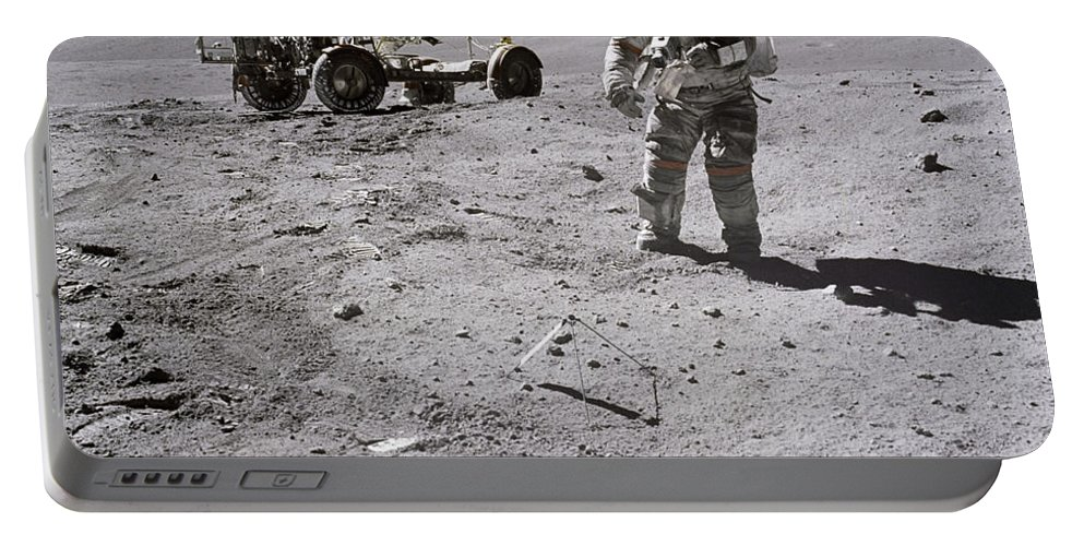 1972 Portable Battery Charger featuring the photograph Apollo 16 Astronaut Collects Samples by Stocktrek Images