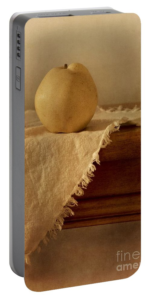 Dining Room Portable Battery Charger featuring the photograph Apple Pear On A Table by Priska Wettstein