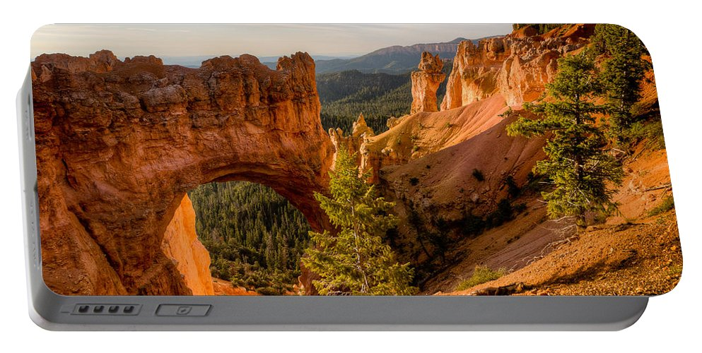 Arch Portable Battery Charger featuring the photograph Arch At Bryce by Rikk Flohr