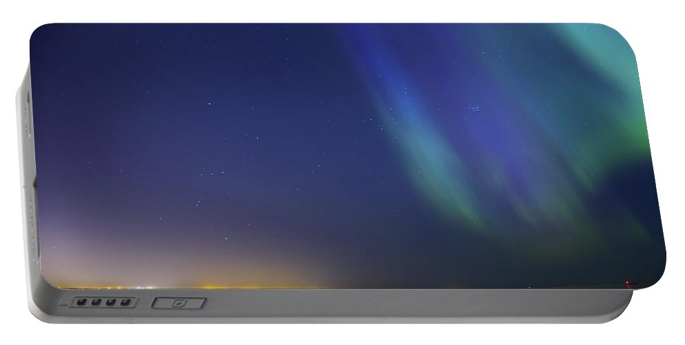 Astronomy Portable Battery Charger featuring the photograph Aurora Borealis Northern Lights Over City Of Tallinn North Europe by Sandra Rugina