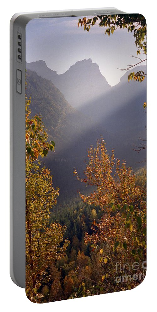 Mountains Portable Battery Charger featuring the photograph Autumn At Logan Pass by Richard Rizzo