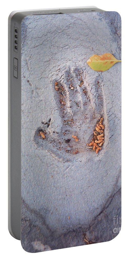 Portable Battery Charger featuring the photograph Autumns Child Or Hand In Concrete by Heather Kirk
