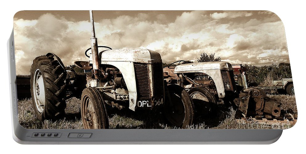 Tractor Portable Battery Charger featuring the photograph Awaiting The Auctioneer by Rob Hawkins