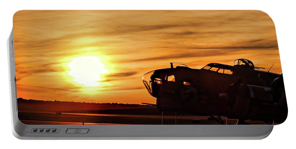 B 17. Flying Fortress Portable Battery Charger featuring the photograph B 17 At Sunset by Bill Dussault