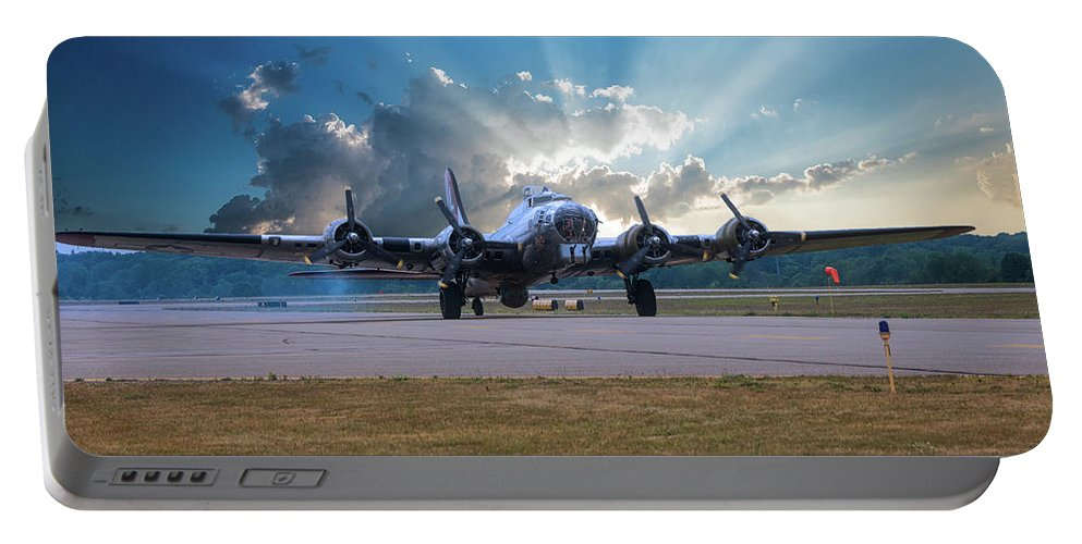Flying Fortress Portable Battery Charger featuring the photograph B17 Landing by Thomas Woolworth