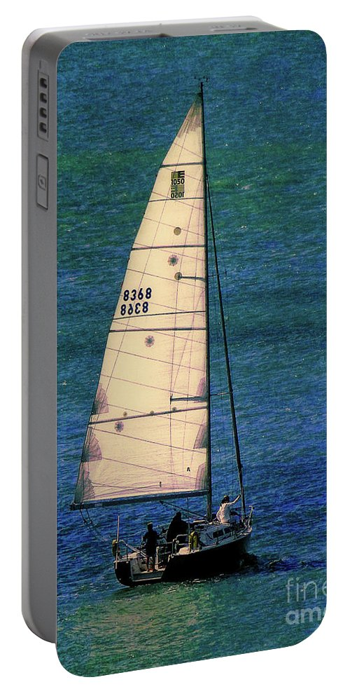 Sailboat Portable Battery Charger featuring the photograph Backlit By The Sun by Sue Melvin