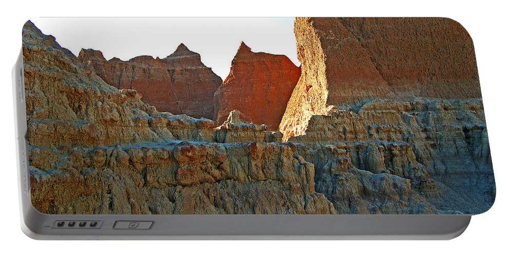 Shadows Portable Battery Charger featuring the photograph Badlands Sunset by Glenn W Smith