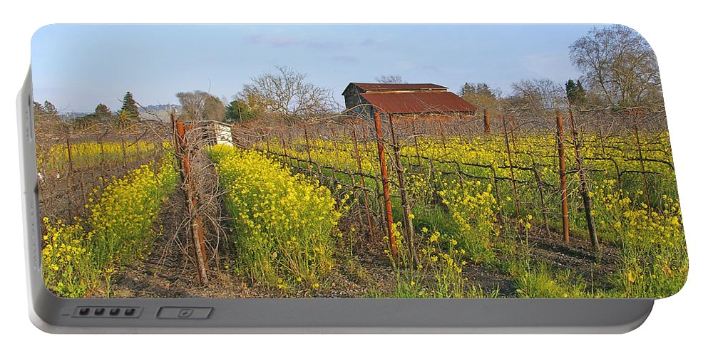 Mustard Portable Battery Charger featuring the photograph Barn Among The Wild Mustard by Tom Reynen