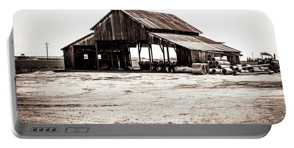 Barn Portable Battery Charger featuring the photograph Barn And Irrigation Pipes by Gene Parks