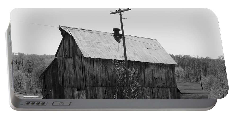 Barns Portable Battery Charger featuring the photograph Barn On The Side Of The Road by Angus Hooper Iii