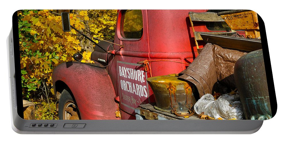Truck Portable Battery Charger featuring the photograph Bayshore Orchards by Tim Nyberg
