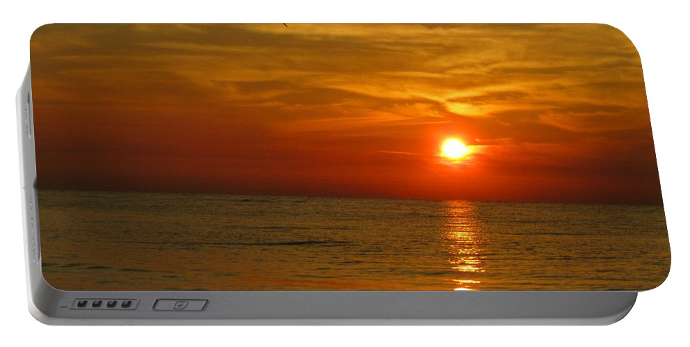 Sunrise Portable Battery Charger featuring the photograph Be Free by Judy Bugg Malinowski