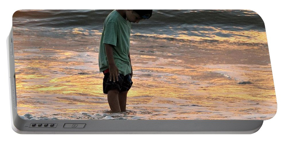 Sunrise On The Beach Portable Battery Charger featuring the photograph Beach Boy by Judy Bugg Malinowski