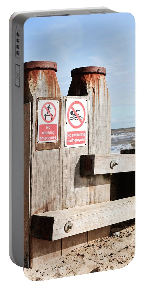 Climbing Portable Battery Charger featuring the photograph Beach Warning by Tom Gowanlock