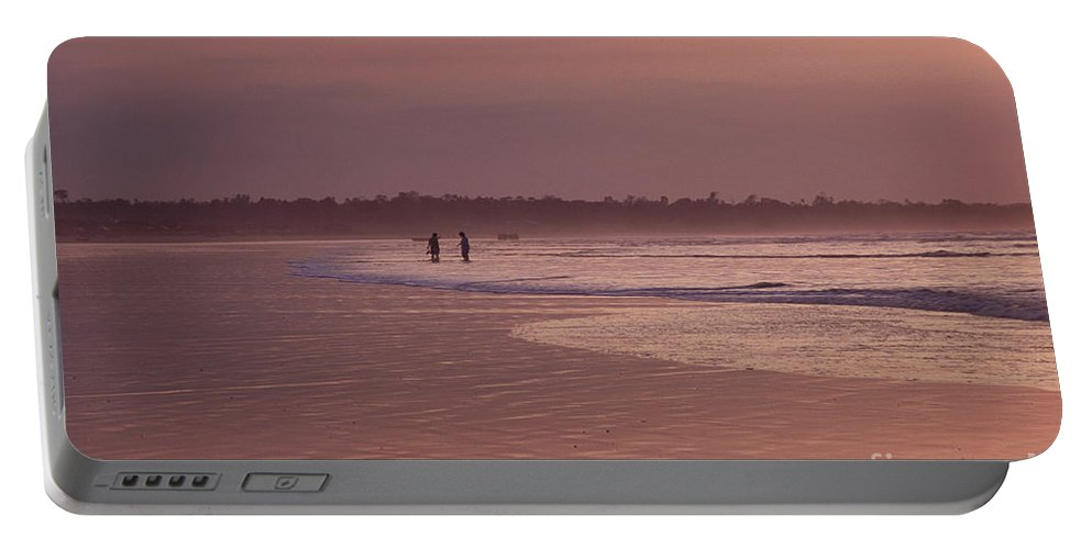 Ecuador Portable Battery Charger featuring the photograph Beachcombers by Kathy McClure