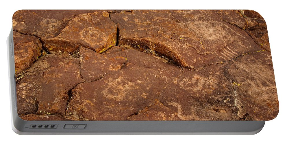 Lava Portable Battery Charger featuring the photograph Belfast Petroglyph 6 by Michele James