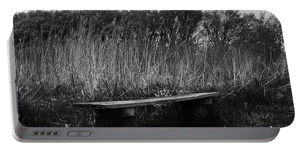 Black And White Portable Battery Charger featuring the photograph Bench In The Prairie by Frank J Casella