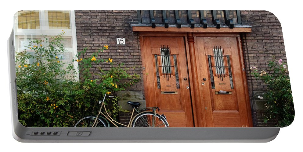 Bicycle Portable Battery Charger featuring the photograph Bicycle And Wooden Door by Thomas Marchessault
