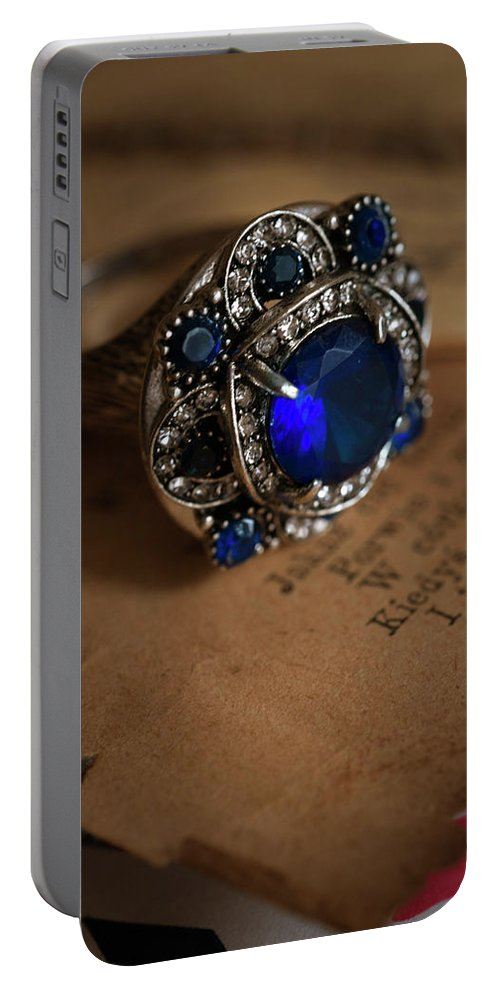 Ring Portable Battery Charger featuring the photograph Big Blue Ornamented Ring by Jaroslaw Blaminsky