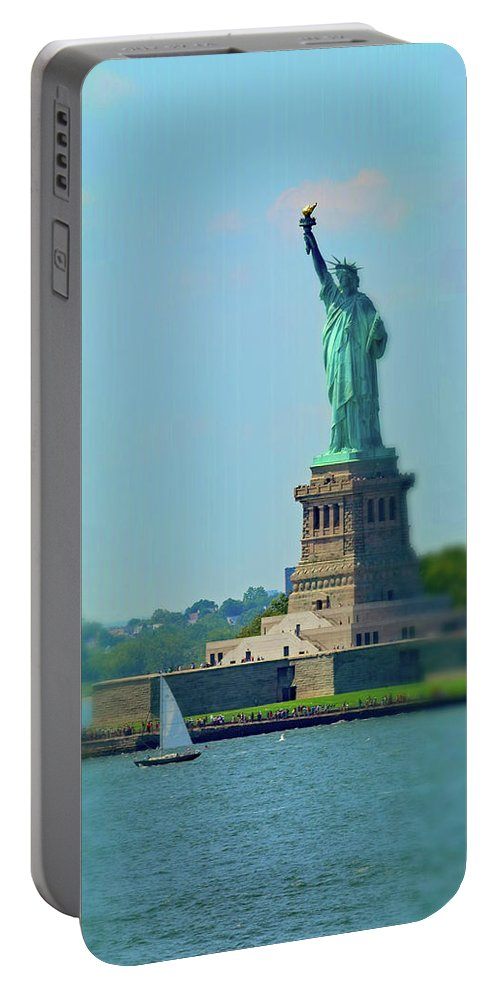 Big Statue Little Boat Portable Battery Charger featuring the photograph Big Statue, Little Boat by Sandy Taylor