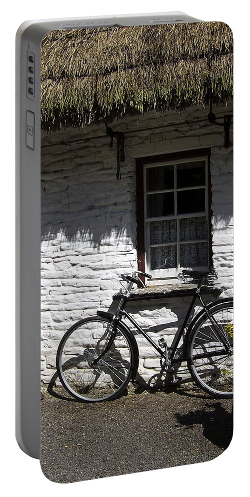 Irish Portable Battery Charger featuring the photograph Bike At The Window County Clare Ireland by Teresa Mucha