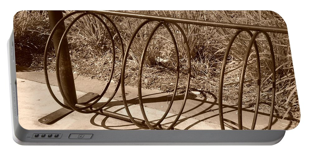 Bicycle Portable Battery Charger featuring the photograph Bike Rack by Rob Hans