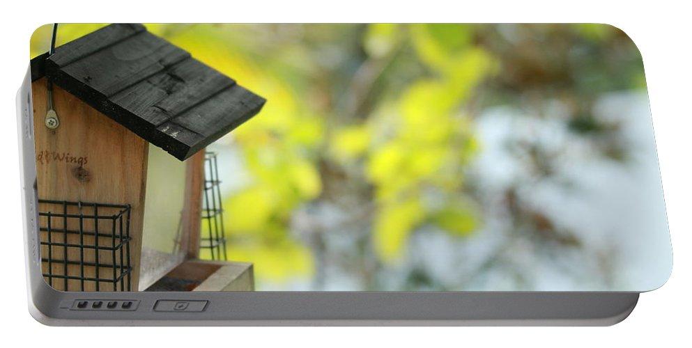 Bird Portable Battery Charger featuring the photograph Bird Feeder by Donald Hazlett