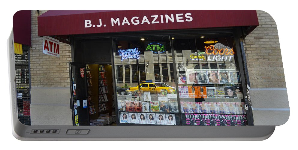 Storefront Portable Battery Charger featuring the photograph B.j. Magazines New York by Erik Burg