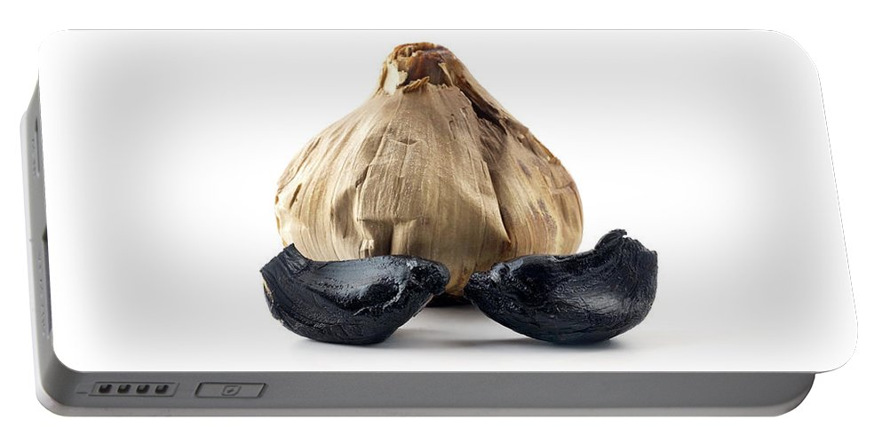 Black Portable Battery Charger featuring the photograph Black Garlic by Fabrizio Troiani