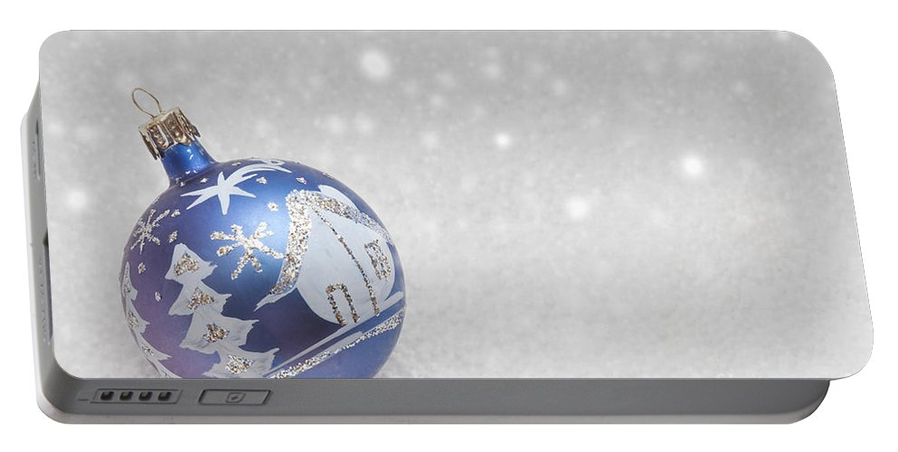 Christmas Portable Battery Charger featuring the photograph Blue Bauble by Diane Macdonald