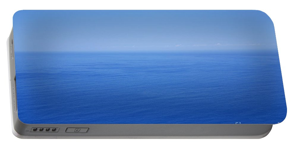 Tranquility Portable Battery Charger featuring the photograph Blue Horizon by Gaspar Avila