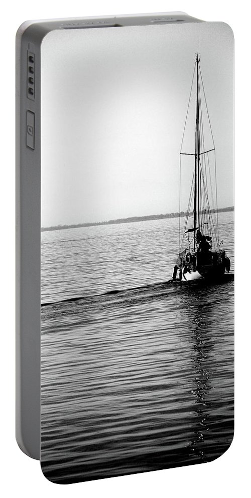 Seascape Portable Battery Charger featuring the photograph Boat At Sea by Aaron Fait