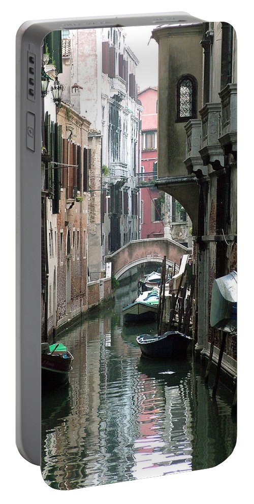 Venice Portable Battery Charger featuring the photograph Boat On The Wall by Donna Corless