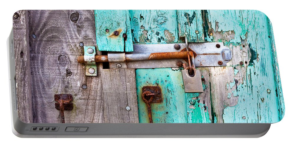 Area Portable Battery Charger featuring the photograph Bolted Door by Tom Gowanlock