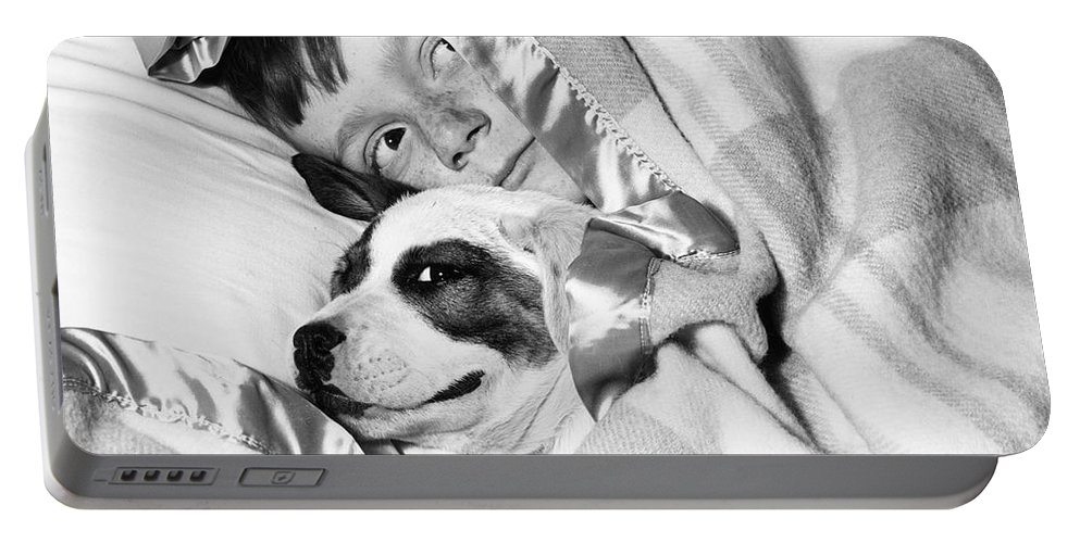 1940s Portable Battery Charger featuring the photograph Boy And Dog Hiding Under Blanket by D. Corson/ClassicStock